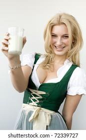 Girl in a dirndl drinking milk
