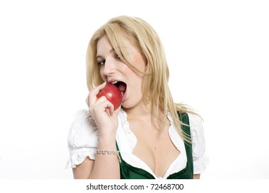 girl in a dirndl eating a apple