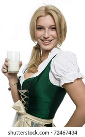 Girl in a dirndl with a glass of milk