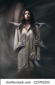 girl in a dirty robe, hand of death, nightmares, insomnia, a mentally ill woman, halloween theme, creepy dream, hands of the demon, hands of the devil in the smoke, horror movie scene with a girl,fear