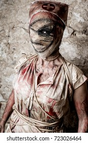 Girl disguised as a zombie nurse, halloween background.