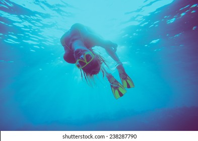 girl dive, underwater scene, vintage style