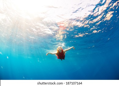 girl diving under the sea