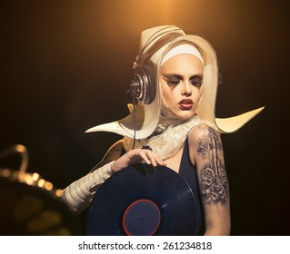 Girl - DJ, in the form of a nun
