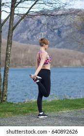 Girl do exercises outdoor