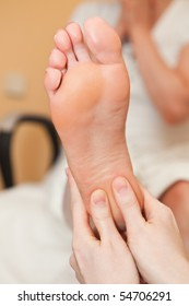To the girl do foot massage in salon close up