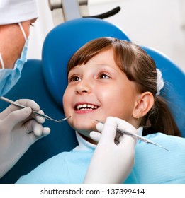 girl with a doctor in a dental office