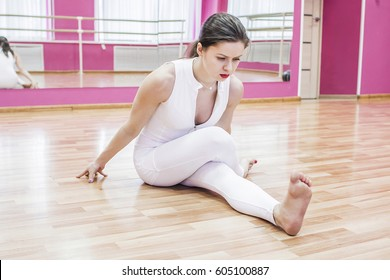 Girl does exercises and yoga in dance class