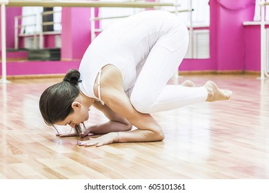 Girl does exercises and yoga in pink dance class