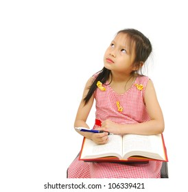The girl does homework, isolated on a white background