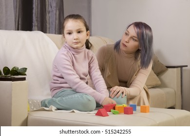 the girl does not respond to the world around us. immersed in thought. Mom turns to the girl. relationship with an autistic child