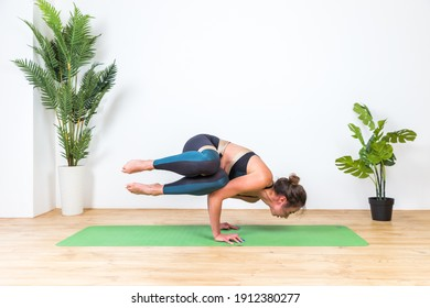 The girl does yoga exercises to stretch the muscles.