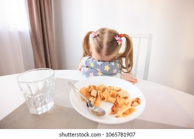 Girl doesn't want eat her dinner. Theme of problems with children feed.