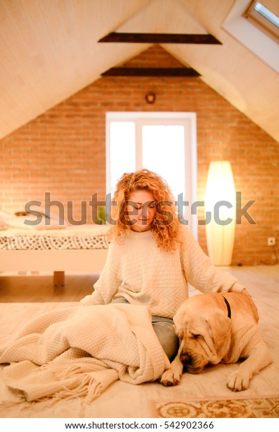 The girl with a dog in the cozy house