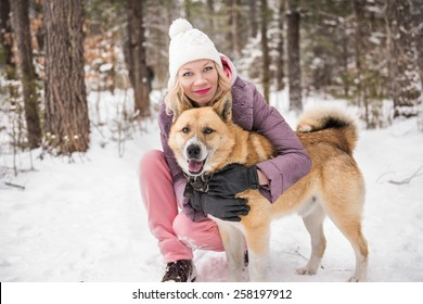 Girl with a dog in the forest