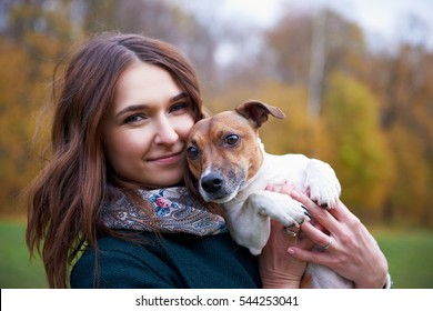 Girl with a dog in park
