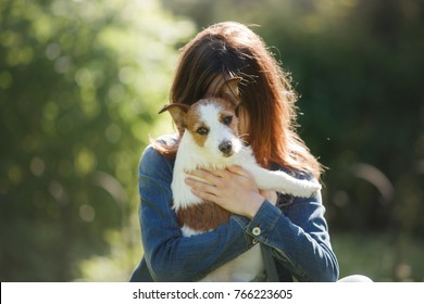 girl with dog play. person and pet together. A little Jack Russell Terrier