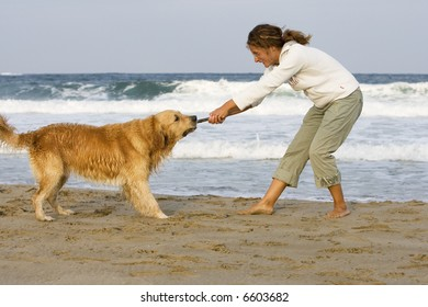 Girl and dog playing