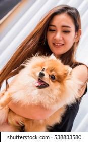girl and dog pomeranian