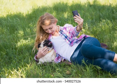 girl with a dog walking in the park