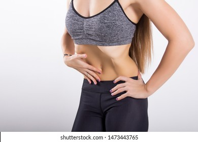 Girl doing abdominal vacuum exercise