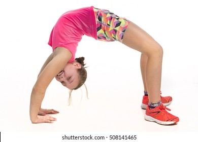 Girl doing a backward stretch while smiling to camera