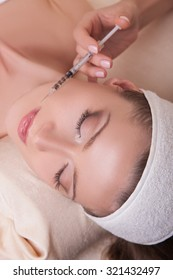 Girl doing beauty injection. anti-aging treatments. Beauty and skin care. Cosmetology. female beauty, facial and body
