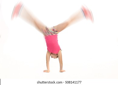 Girl doing a cartwheel at high speed.