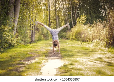 girl doing cartwheel in the park