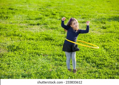 girl doing exercise with plastic circle