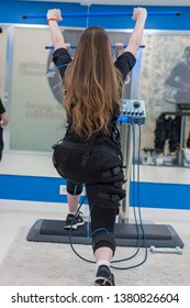 a girl doing exercises in electrofitness