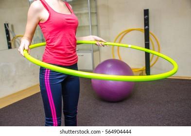 Girl doing exercises with hoop