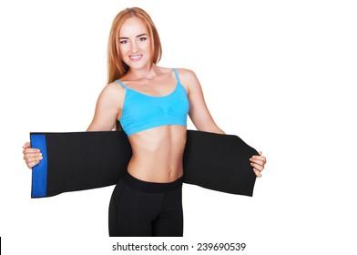 Girl doing fitness blue belt slimming isolated on white background