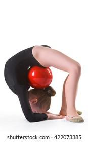 Girl doing gymnastic exercises or exercising on white background