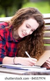 Girl doing her homework outdoors