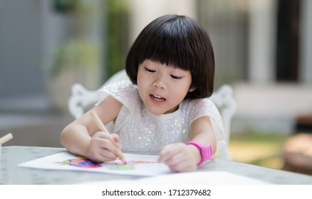 girl doing homework at home, kid writing paper, education concept, back to school, stay home