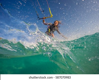 Girl doing Kitesurfing (kite-boarding)