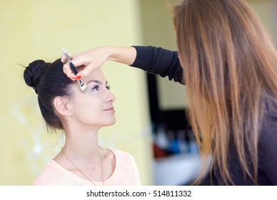 Girl doing make-up in a beauty salon
