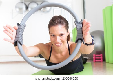 girl doing pilates with ring
