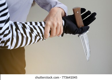 A girl is doing self defense by twists theft's wrist that threaten her with knife