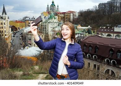 girl doing selfie on city background