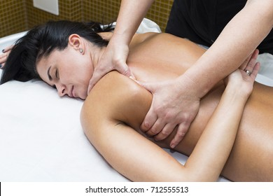 A girl doing a therapeutic massage at a spa salon