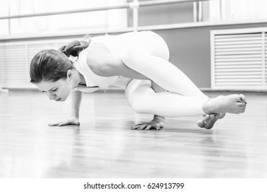 GIrl is doing yoga and exercises