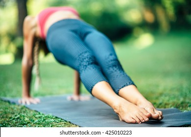 Girl doing Yoga, Reverse Plank Pose or Purvottanasana