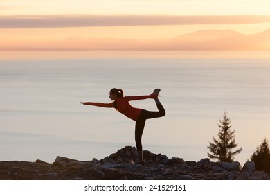 Girl doing yoga at sunset with sea background