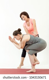 girl doing yoga under the guidance of a trainer