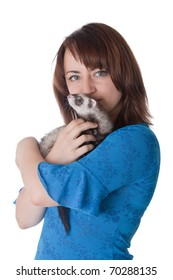 The girl with a domestic polecat in hands