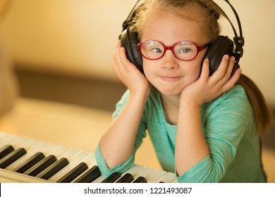 Girl with Down syndrome enjoys music