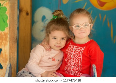Girl with Down syndrome with her friend