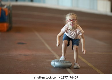 A girl with Down syndrome is involved in athletics